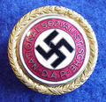 GOLD PARTY BADGE OF THE NSDAP BELONGING TO KREISLEITER LUDWIG WINTER.