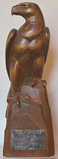 LUFTWAFFE CARVED WOODEN EAGLE WITH 1943 PRESENTATION INSCRIPTION.