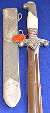 UNISSUED RAD OFFICERS DAGGER BY WKC WITH ORIGINAL ISSUE TAG.