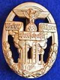 DEFENSE OF THE WAR ECONOMY BADGE IN GOLD.