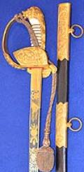 UNIQUE IMPERIAL GERMAN NAVAL OFFICERS SWORD WITH DAMASCUSE BLADE AND DELUXE SCABBARD FITTINGS.