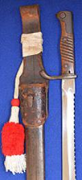 IMPERIAL GERMAN MOUSER BAYONET WITH SAWBACKED BLADE COMPLETE WITH LEATHER FROG AND  PORTEPEE.