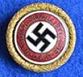 LARGE SIZE GOLD PARTY BADGE OF THE NSDAP STILL IN FULL GILT.
