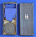 CASED SS 4 YEAR LONG SERVICE MEDAL.