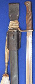 IMPERIAL GERMAN 1898 / 05 SAWBACK BAYONET COMPLETE WITH FROG AND KNOT.