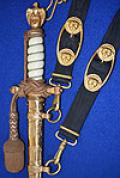 GERMAN NAVAL OFFICERS DAGGER IN MINT CONDITION BY EICKHORN WITH MATCHING HANGERS AND GOLD KNOT.