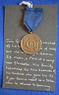 SS 8 YEAR SERVICE MEDAL WITH INTERESTING HISTORY.