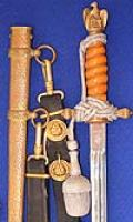 THIRD REICH NAVAL DAGGER 1938 MODEL BY WKC WITH DARK ORANGE GRIP,HAMMERED SCABBARD.