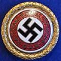 GOLD PARTY BADGE OF THE NSDAP, SPECIAL ADOLF HITLER AWARD FOR 1943 WITH UNIQUE DATE.