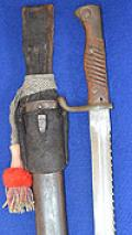 IMPERIAL GERMAN 1898/05 MODEL BAYONET WITH SAWBACK BLADE COMPLETE WITH PORTEPEE AND LEATHER FROG.