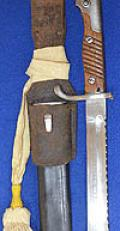IMPERIAL GERMAN S98/05 BAYONET WITH SAWBACK BLADE & LEATHER SCABBARD,WITH LEATHER FROG & KNOT.
