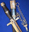GERMAN POSTAL LEADERS DAGGER BY PAUL WAYERSBERG COMPLETE WITH CHAIN HANGER.