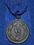 SS FOUR YEAR MEDAL WITH RIBBON.